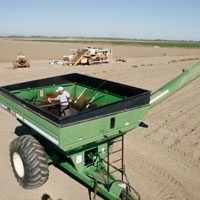 Man applying Fluid Film on Fertilizer Spreader