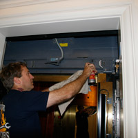Man applying Fluid Film on electric door
